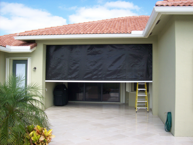 Hurricane door shutters description of diy how to make for Storm door with roll up screen
